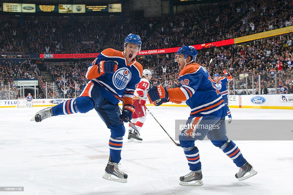 Taylor Hall #4 and Shawn Horcoff #10 of the Edmonton Oilers celebrate a second period goal against the Detroit Red Wings at Rexall Place on November 5, 2010 in Edmonton, Alberta, Canada.