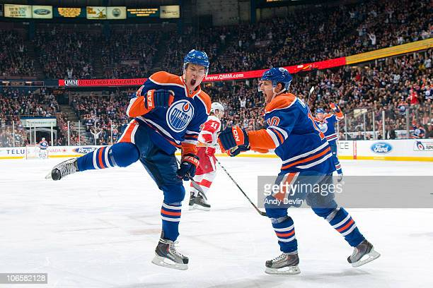 Taylor Hall and Shawn Horcoff of the Edmonton Oilers celebrate a second period goal against the Detroit Red Wings at Rexall Place on November 5 2010...