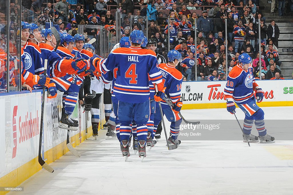 Taylor Hall #4 and team mates of the Edmonton Oilers celebrate after scoring a goal in a game against the Colorado Avalanche at Rexall Place on January 28, 2013 in Edmonton, Alberta, Canada.