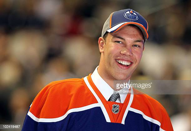 Taylor Hall drafted overall by the Edmonton Oilers smiles to the crowd after being drafted during the 2010 NHL Entry Draft at Staples Center on June...