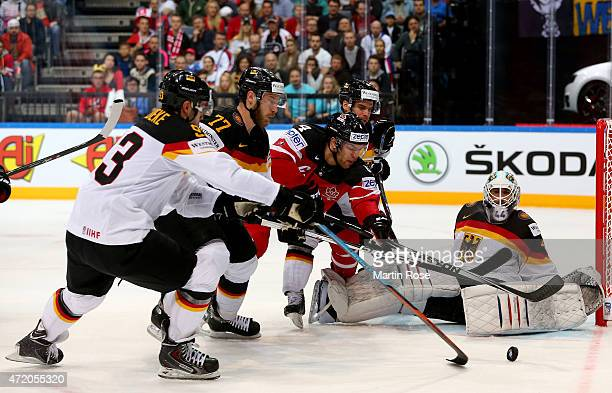 Taylor Hall of Canada tries to score over Dennis Endras goaltender of Germany during the IIHF World Championship group A match between Canada and...