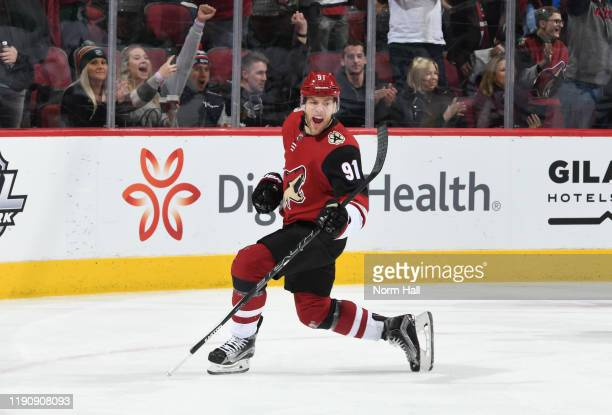Taylor Hall of the Arizona Coyotes celebrates after scoring a goal against the Dallas Stars during the first period of the NHL hockey game at Gila...
