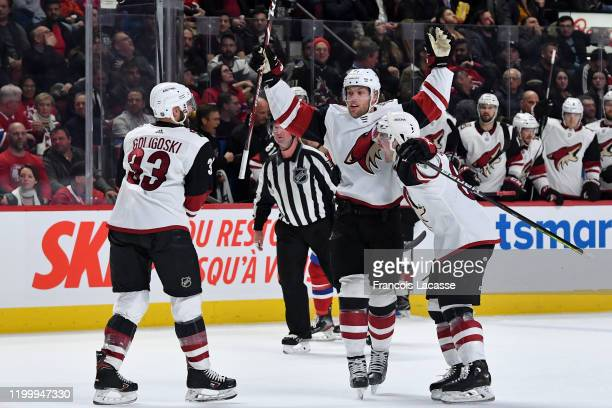 Taylor Hall of the Arizona Coyotes celebrates with teammates after scoring a goal against the Montreal Canadiens in the NHL game at the Bell Centre...