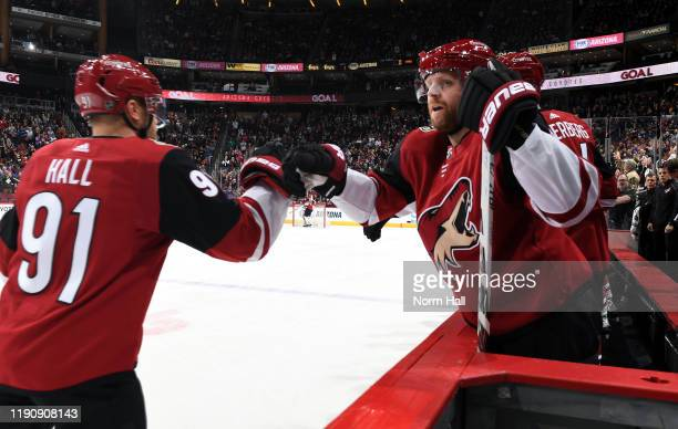 Taylor Hall of the Arizona Coyotes is congratulated by teammate Phil Kessel of the Coyotes after scoring a goal against the Dallas Stars during the...