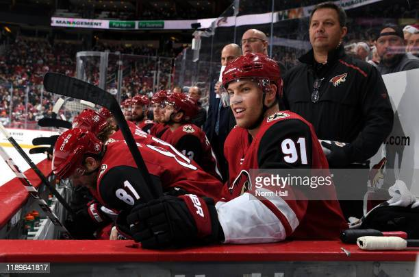 Taylor Hall of the Arizona Coyotes looks on from the bench during the first period of the NHL hockey game against the Minnesota Wild at Gila River...