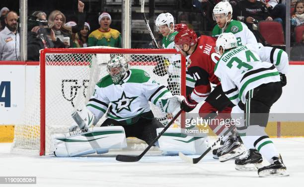 Taylor Hall of the Arizona Coyotes shoots the puck past goalie Anton Khudobin of the Dallas Stars for a goal during the first period of the NHL...