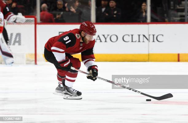 Taylor Hall of the Arizona Coyotes skates with the puck against the Florida Panthers at Gila River Arena on February 25 2020 in Glendale Arizona
