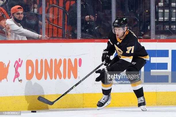 Taylor Hall of the Boston Bruins skates with the puck against the Philadelphia Flyers at Wells Fargo Center on October 20, 2021 in Philadelphia,...