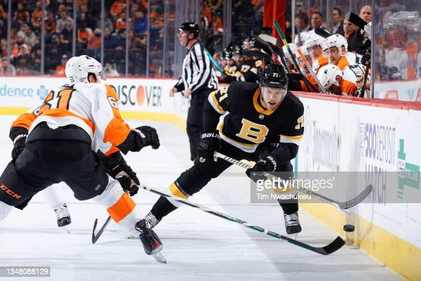 Taylor Hall of the Boston Bruins tries to skate past Justin Braun of the Philadelphia Flyers at Wells Fargo Center on October 20, 2021 in...