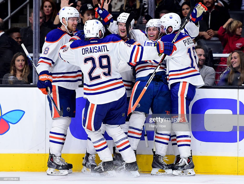 Taylor Hall #4 of the Edmonton Oilers celebrates his goal with his teammates to tie the game 3-3 with the Los Angeles Kings at Staples Center on November 14, 2015 in Los Angeles, California.
