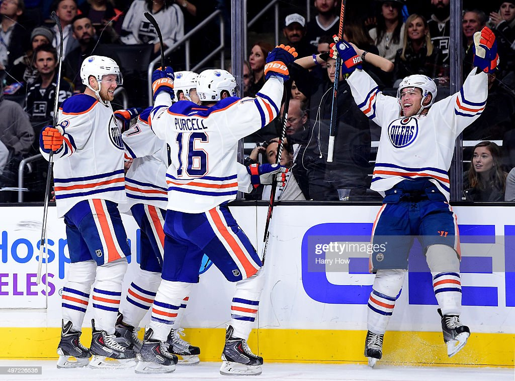 Taylor Hall #4 of the Edmonton Oilers celebrates his goal with his teammates to tie the game 3-3 with the Los Angeles Kings during the third period at Staples Center on November 14, 2015 in Los Angeles, California.