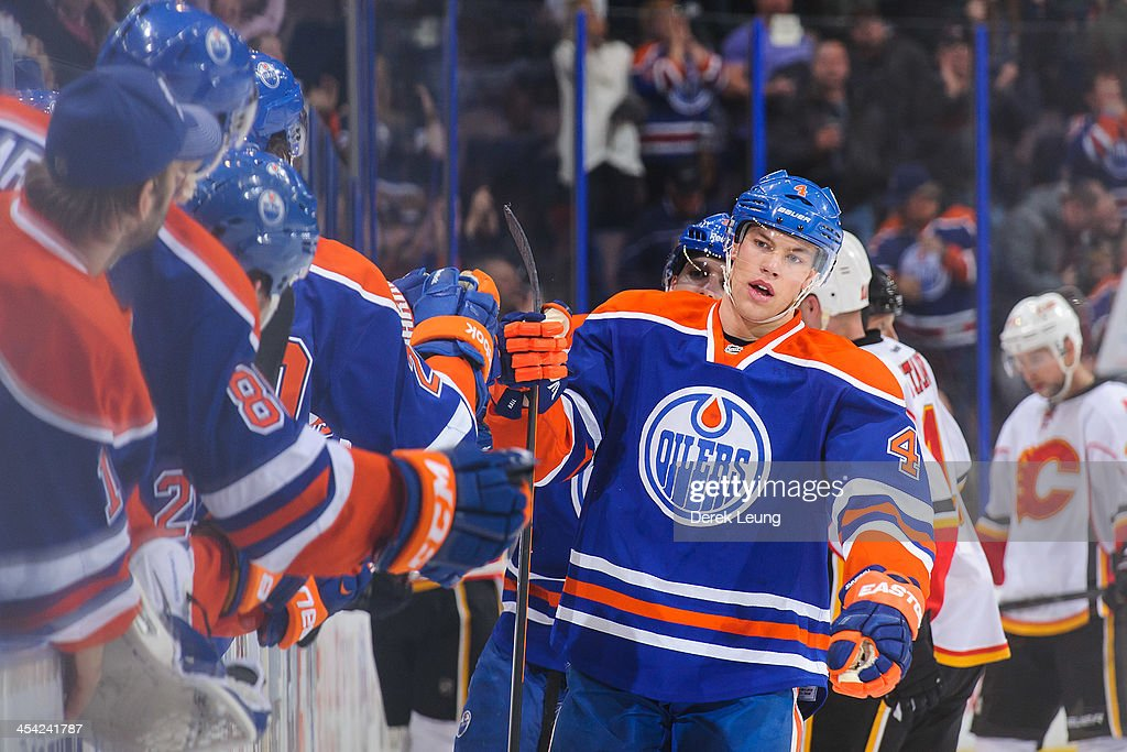 Taylor Hall #4 of the Edmonton Oilers celebrates with the bench after scoring the game-tying goal to force overtime against the Calgary Flames during an NHL game at Rexall Place on December 7, 2013 in Edmonton, Alberta, Canada. The Flames defeated the Oilers 2-1 in overtime.