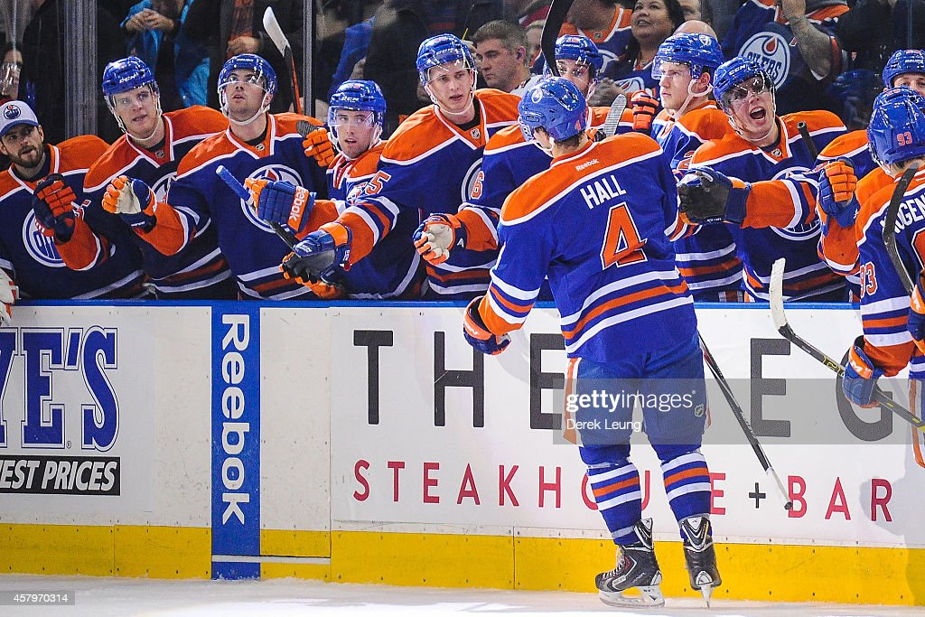 Taylor Hall #4 of the Edmonton Oilers celebrates with the bench after scoring his team's third goal against the Montreal Canadiens during an NHL game at Rexall Place on October 27, 2014 in Edmonton, Alberta, Canada. The Oilers defeated the Canadiens 3-0.