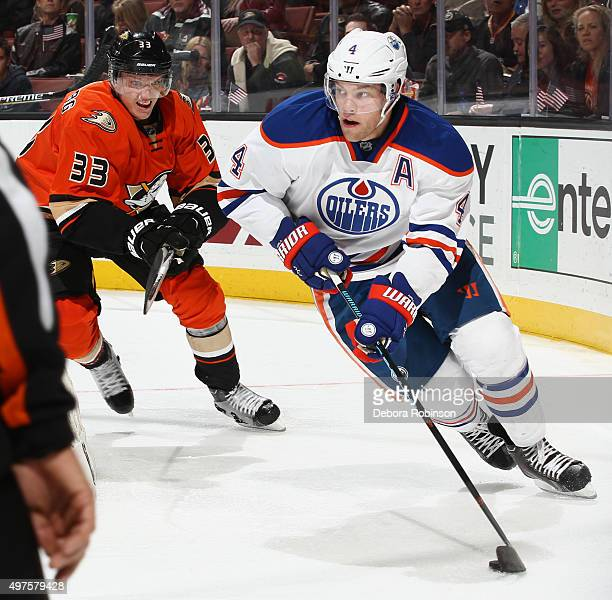 Taylor Hall of the Edmonton Oilers controls the puck against Jakob Silfverberg of the Anaheim Ducks on November 11 2015 at Honda Center in Anaheim...