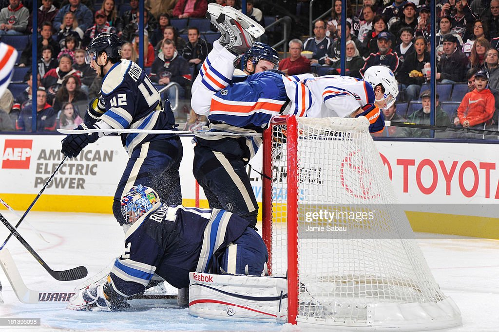 Taylor Hall #4 of the Edmonton Oilers gets caught on the top of the net after goaltender Sergei Bobrovsky #72 of the Columbus Blue Jackets makes a save in the second period on February 10, 2013 at Nationwide Arena in Columbus, Ohio.