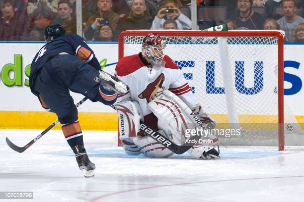 Taylor Hall of the Edmonton Oilers scores a shootout goal past Ilya Bryzgalov of the Phoenix Coyotes at Rexall Place on November 19 2010 in Edmonton...