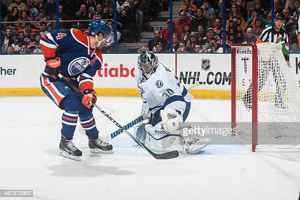 Taylor Hall of the Edmonton Oilers scores on a penalty shot on Ben Bishop of the Tampa Bay Lightning on October 20 2014 at Rexall Place in Edmonton...