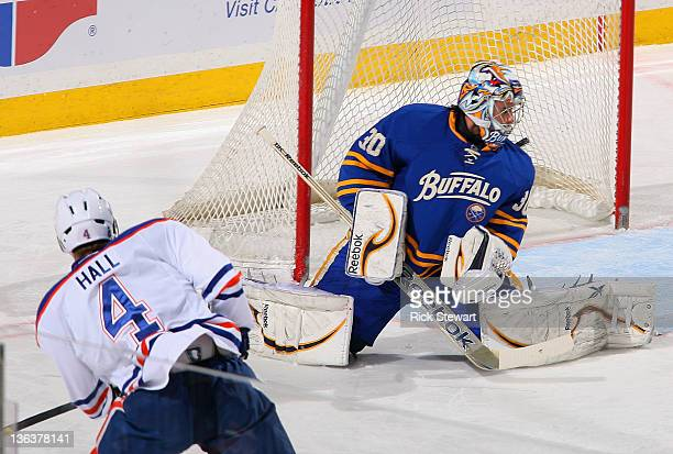 Taylor Hall of the Edmonton Oilers scores on Ryan Miller of the Buffalo Sabres in the first period at First Niagara Center on January 3 2012 in...