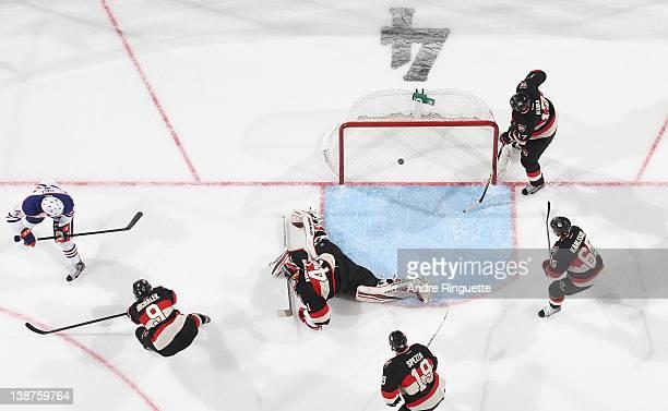 Taylor Hall of the Edmonton Oilers scores the overtime gamewinning goal against Milan Michalek Craig Anderson Jason Spezza Erik Karlsson and Filip...