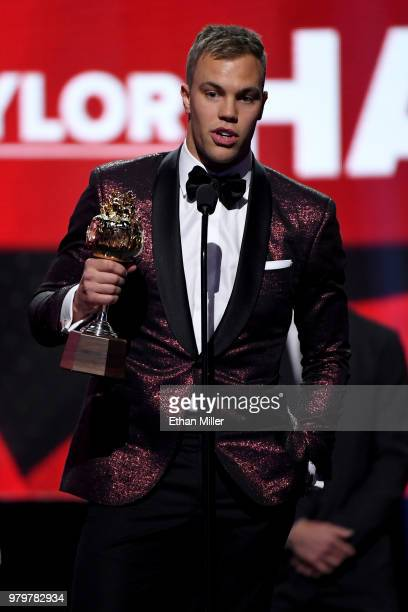 Taylor Hall of the New Jersey Devils accepts the Hart Trophy given to the most valuable player to his team onstage at the 2018 NHL Awards presented...