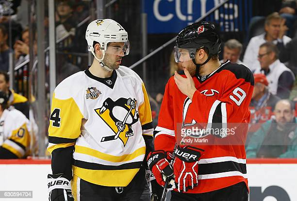 Taylor Hall of the New Jersey Devils and Justin Schultz of the Pittsburgh Penguins talk during the game at Prudential Center on December 27 2016 in...