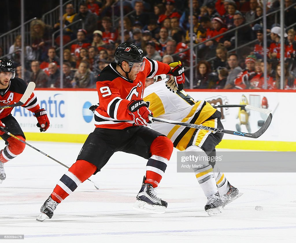 Taylor Hall #9 of the New Jersey Devils avoids a check by Steve Olesky #61 of the Pittsburgh Penguins during the game at Prudential Center on December 27, 2016 in Newark, New Jersey.