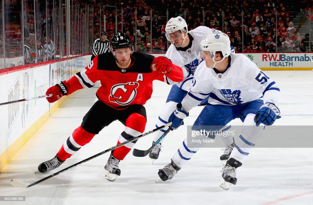 Taylor Hall #9 of the New Jersey Devils battles for postion against Jake Gardiner #51 of the Toronto Maple Leafs during the game at Prudential Center on April 5, 2018 in Newark, New Jersey.