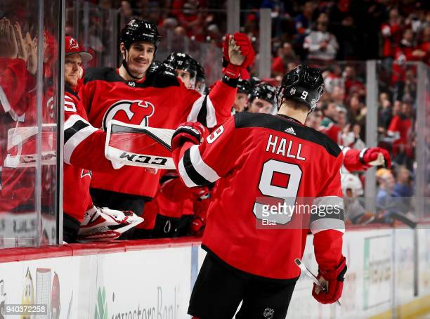 Taylor Hall of the New Jersey Devils celebrates his goal with teammates on the bench in the second period against the New York Islanders on March 31...