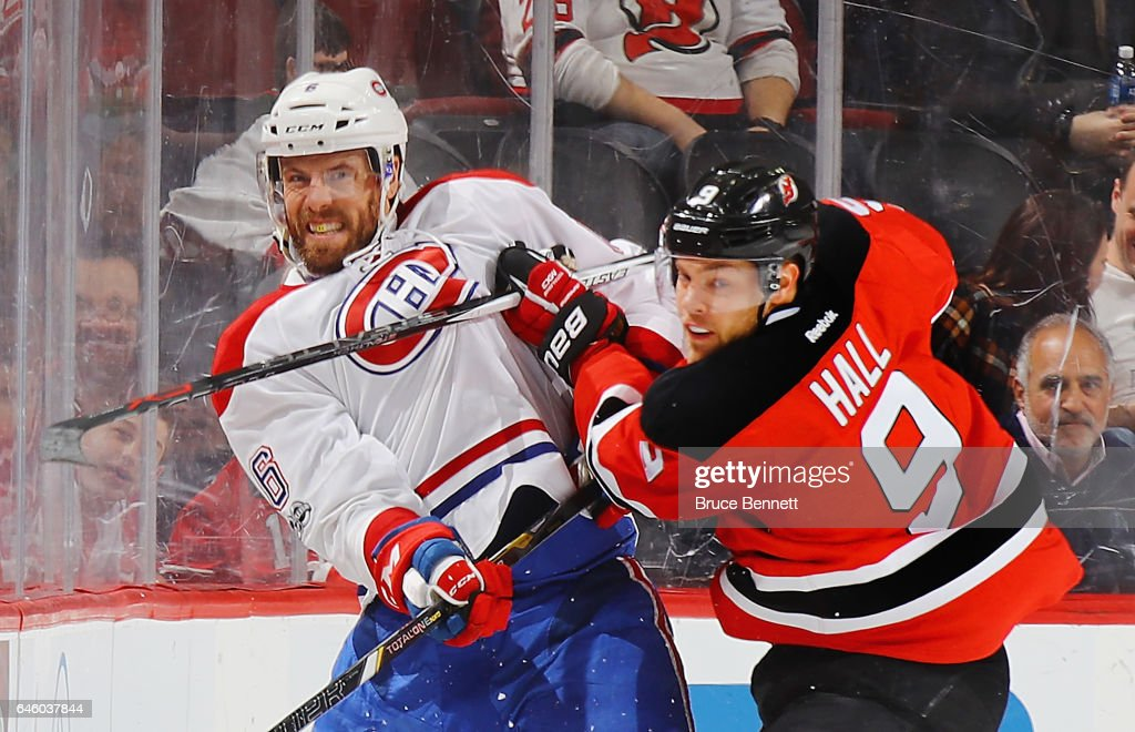 Taylor Hall #9 of the New Jersey Devils gets the stick up on Shea Weber #6 of the Montreal Canadiens during the first period at the Prudential Center on February 27, 2017 in Newark, New Jersey.