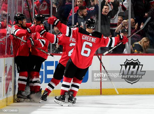 Taylor Hall of the New Jersey Devils is congratulated by teammates Travis ZajacKyle Palmieri and Andy Greene of the New Jersey Devils after Hall...