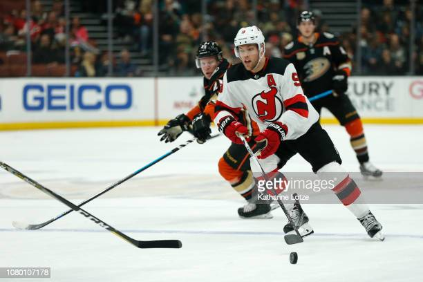 Taylor Hall of the New Jersey Devils looks for an opening against the Anaheim Ducks at Honda Center on December 09 2018 in Anaheim California