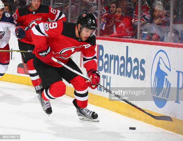 Taylor Hall of the New Jersey Devils plays the puck against the Columbus Blue Jackets during the game at Prudential Center on December 8 2017 in...