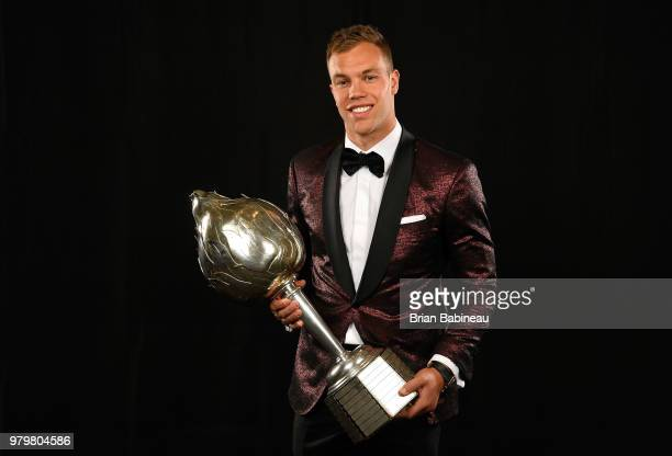 Taylor Hall of the New Jersey Devils poses for a portrait with the Hart Trophy at the 2018 NHL Awards at the Hard Rock Hotel Casino on June 20 2018...