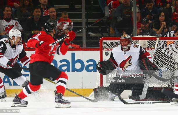 Taylor Hall of the New Jersey Devils puts the puck past Louis Domingue of the Arizona Coyotes for a secondperiod goal during the game at Prudential...