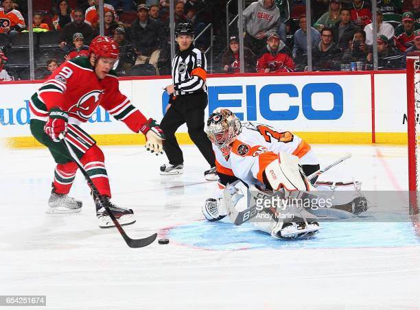 Taylor Hall of the New Jersey Devils scores a goal against Steve Mason of the Philadelphia Flyers during the game at Prudential Center on March 16...