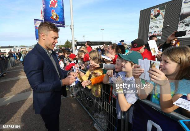 Taylor Hall of the New Jersey Devils signs autographs for fans during Kraft Hockeyville Canada on September 25 2017 at Credit Union Place in...