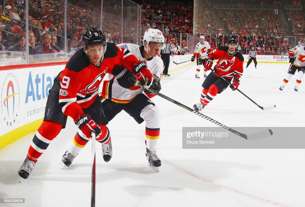 Taylor Hall #9 of the New Jersey Devils skates against the Calgary Flames at the Prudential Center on February 3, 2017 in Newark, New Jersey. The Flames defeated the Devils 4-3 in overtime.