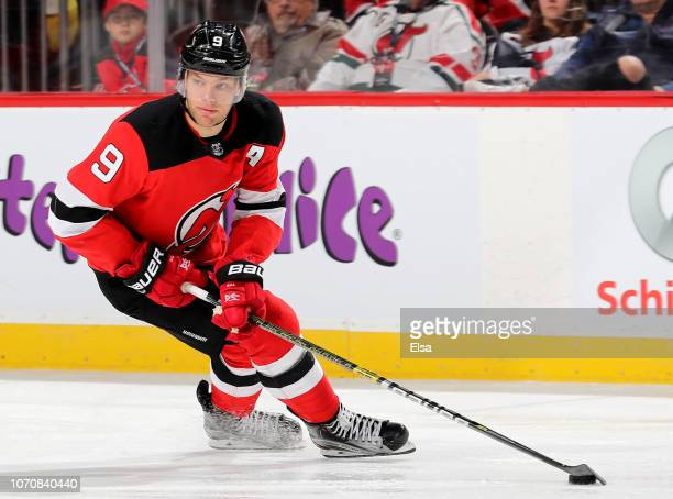Taylor Hall of the New Jersey Devils takes the puck against the Montreal Canadiens at Prudential Center on November 21 2018 in Newark New Jersey