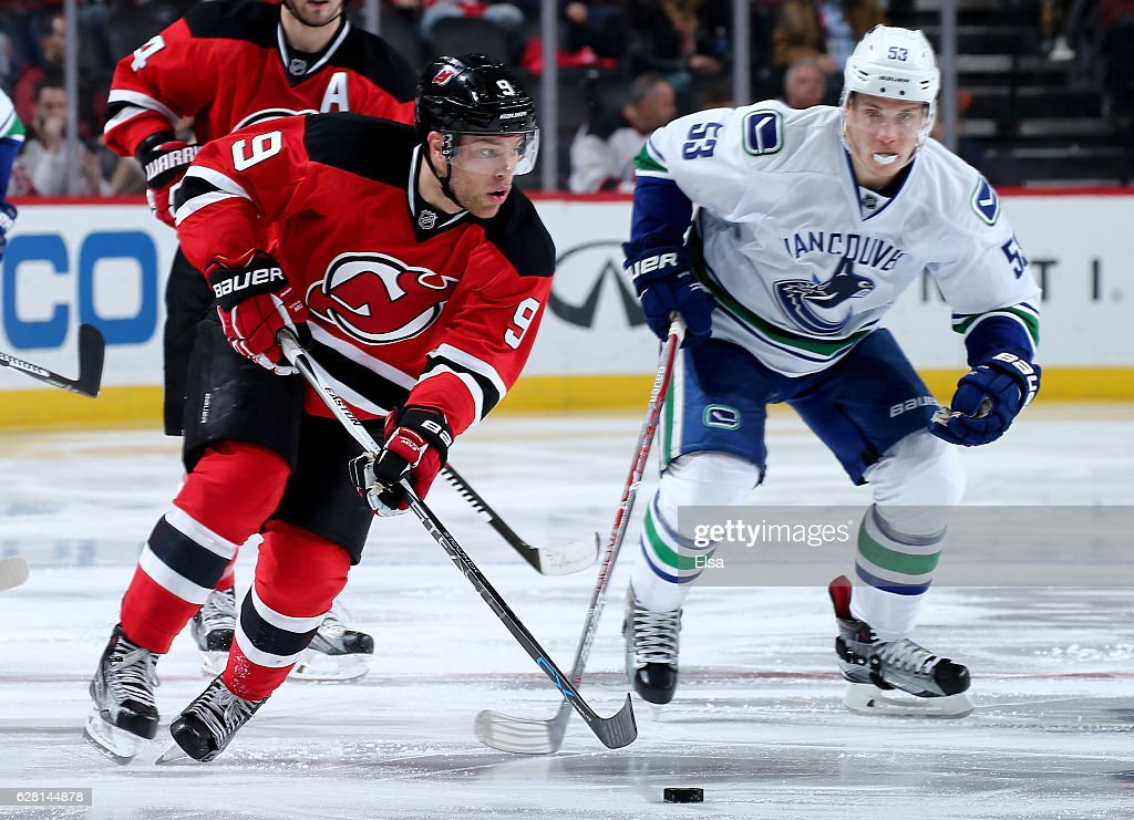 Taylor Hall #9 of the New Jersey Devils takes the puck as Bo Horvat #53 of the Vancouver Canucks defends on December 6, 2016 at Prudential Center in Newark, New Jersey.