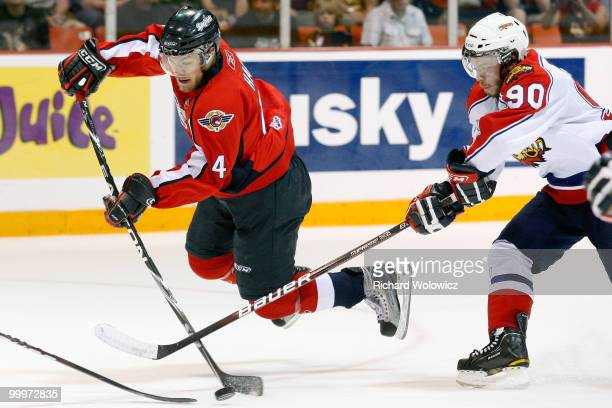 Taylor Hall of the Windsor Spitfires shoots the puck while being defended by Kelsey Tessier of the Moncton Wildcats during the 2010 Mastercard...