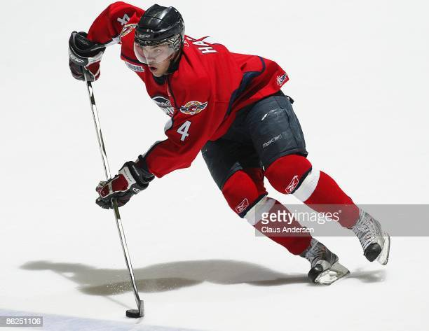 Taylor Hall of the Windsor Spitfires skates up ice with the puck in game 5 of the Western Conference Championship against the London Knights on April...