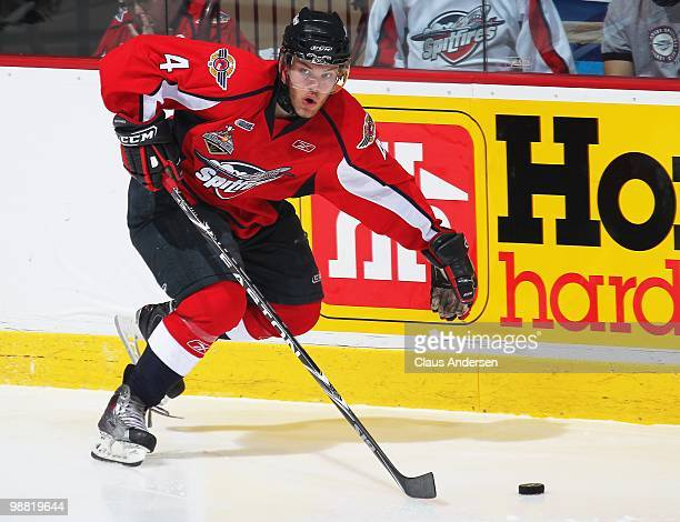Taylor Hall of the Windsor Spitfires skates up ice with the puck in the third game of the OHL Championship final against the Barrie Colts on May...