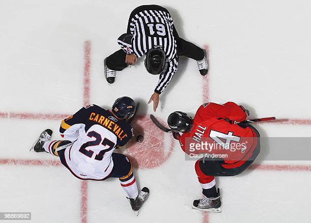 Taylor Hall of the Windsor Spitfires takes a faceoff against Taylor Carnevale of the Barrie Colts in the 4th game of the OHL Championship Final on...