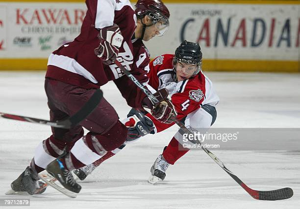 Taylor Hall of the Windsor Spitfires tries to knock the puck away from Justin Soryal of the Peterborough Petes in a game on February 9 2008 at the...