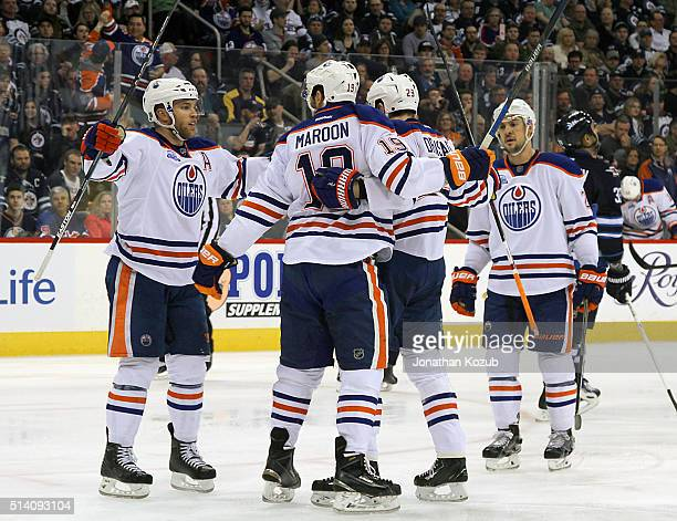Taylor Hall Patrick Maroon Leon Draisaitl and Adam Clendening of the Edmonton Oilers celebrate a second period goal against the Winnipeg Jets at the...