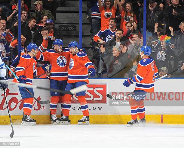 Taylor Hall Teddy Purcell Leon Draisaitl and Andrej Sekera of the Edmonton Oilers celebrate after a goal during a game against the Winnipeg Jets on...