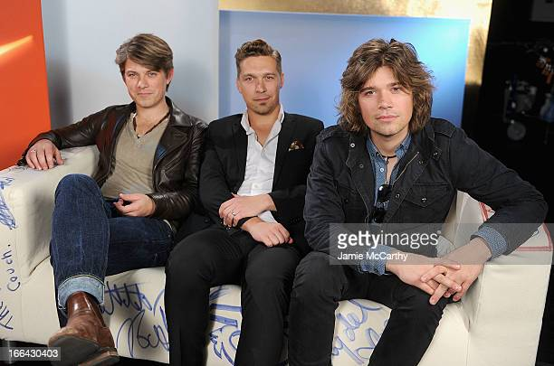 Taylor Hanson Isaac Hanson and Zac Hanson of the band Hanson visit 'UA' at Music Choice on April 12 2013 in New York City