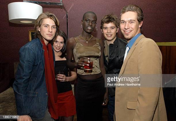Taylor Hanson with his wife Natalie Ford Models' Ajuma Nasenyana Zac Hanson and Isaac Hanson
