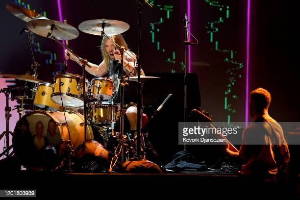 Taylor Hawkins and Nate Mendel of Foo Fighters perform onstage during MusiCares Person of the Year honoring Aerosmith at West Hall at Los Angeles...