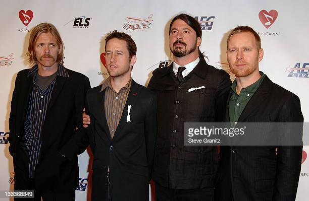 Taylor Hawkins Chris Shiflett Dave Grohl and Nate Mendel of the Foo Fighters arrive at the 2009 MusiCares Person of the Year Tribute to Neil Diamond...